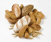 foto of whole-wheat  - Variety of whole wheat bread on white - JPG