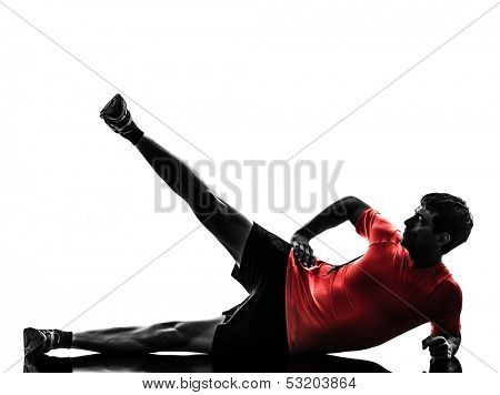 one  man exercising fitness workout legs in the air lying on side in silhouette  on white background
