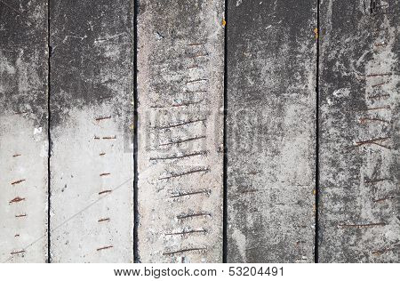 Background Texture Of Old Concrete Wall With Rusted Metal Armature Elements