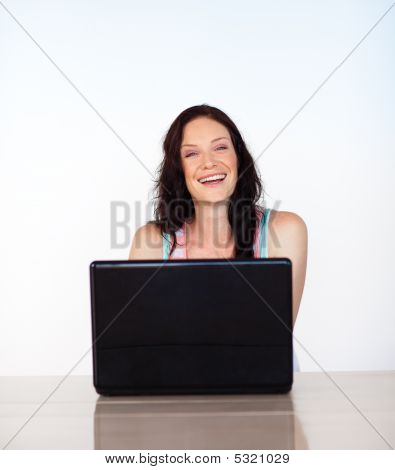 Portrait Of A Smiling Woman With Her Laptop
