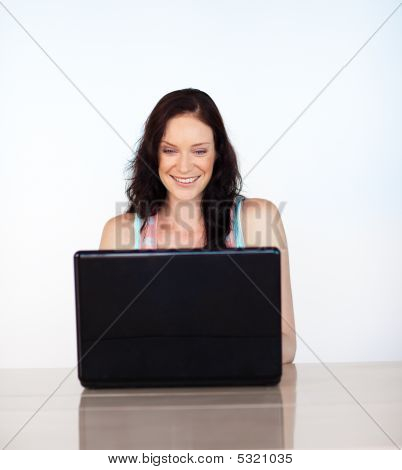 Smiling Woman Concentrated On Her Laptop