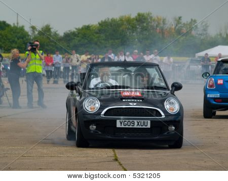 Grimsby, England - June 21St: Famous Stunt Car Driver Russ Swift Entertains The Crowds At The New Mi