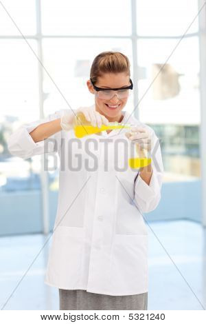 Beautiful Scientist Examining A Test-tube