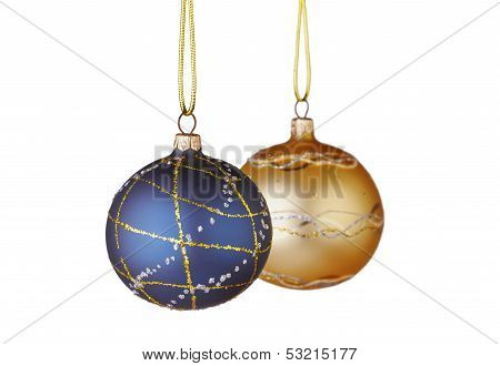 Christmas Decoration. Blue And Yellow  Balls On White Background. Selective Focus