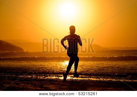 Woman Running On Beautiful Sunset