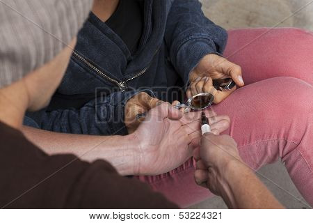 Man Taking A Dose Of Heroin