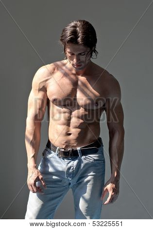 Handsome Muscular Man Shirtless On Grey Background