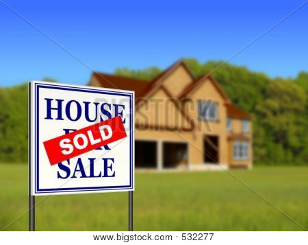 Real Estate Sold Sign and New Home