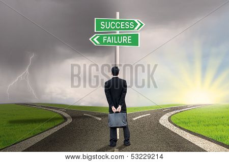 Businessman With Briefcase Looking At Success Or Failure