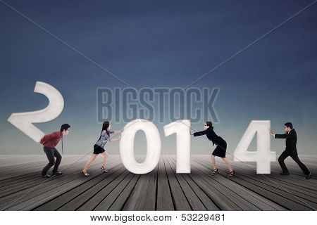 Business people Arrange New Year 2014