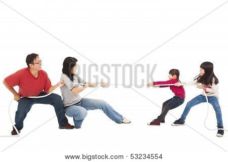 Happy Family Playing Tug Of War
