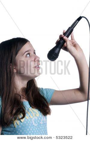 Teenage Girl Singing On White