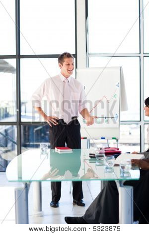 Young Businessman Talking In A Presentation