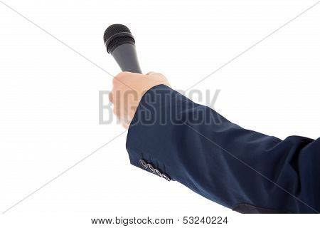 Reporter's Hand Holding A Microphone Isolated Over White