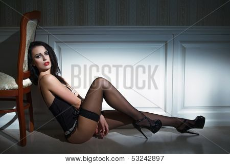 Sexy Brunette Model Sitting On The Floor
