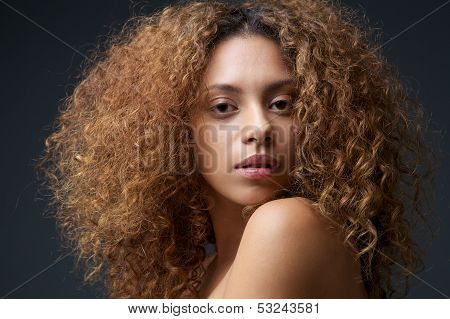 Beauty Portrait Of A Beautiful Female Fashion Model With Curly Hair