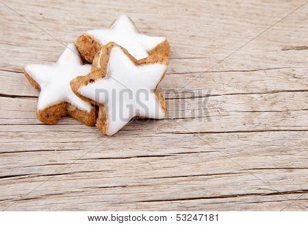 Three cinnamon stars on old wood