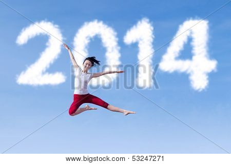 Excited Woman Dancing With New Year 2014