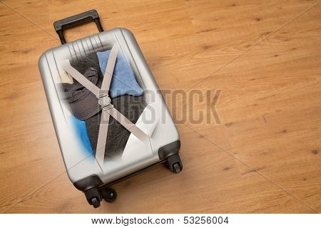 Travel Suitcase Packed With Clothes