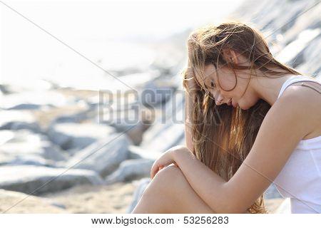 Worried Woman On The Beach