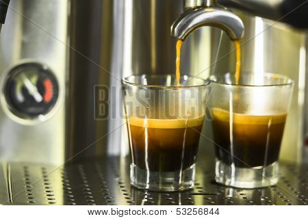 Two Shots Of Espresso Being Drawn