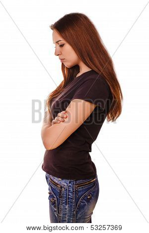 resentful sad brunette woman looking down in a black vest and je