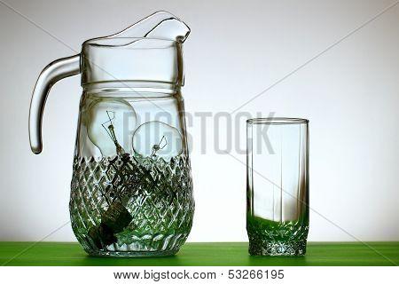 Glass Jug Of Light Bulbs