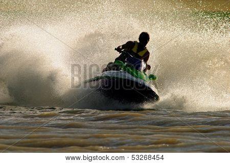 Backlit jet ski with water spray