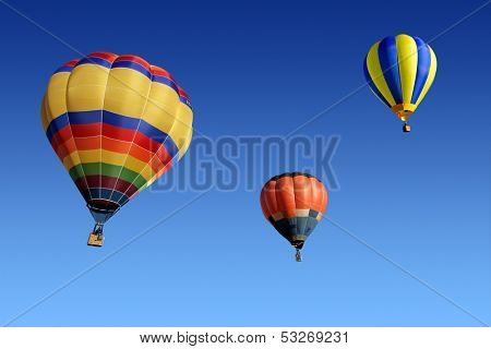 Colorful hot air balloons against a clear blue sky