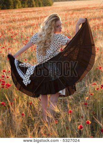 Blonde Walking In Poppy Field