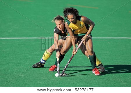 BLOEMFONTEIN, SOUTH AFRICA - FEBRUARY 7: Gaelle Valcke (L) and Marsha Marescia (R) during a women's field hockey match between South Africa and Belgium, Bloemfontein, South Africa, 7 February 2011