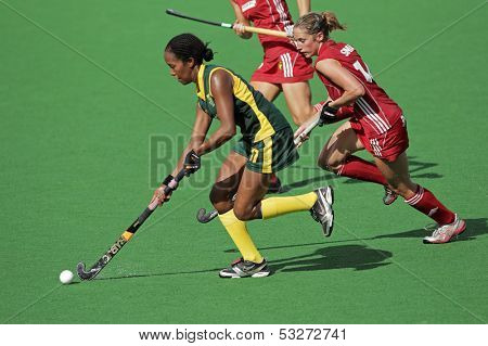 BLOEMFONTEIN, SOUTH AFRICA - FEBRUARY 8: Leslie-Ann George (L) and Emilie Sinia (R) during a womens field hockey match between South Africa and Belgium, Bloemfontein, South Africa, 8 February 2011