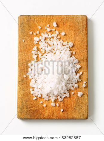 crystal salt on a wooden cutting board