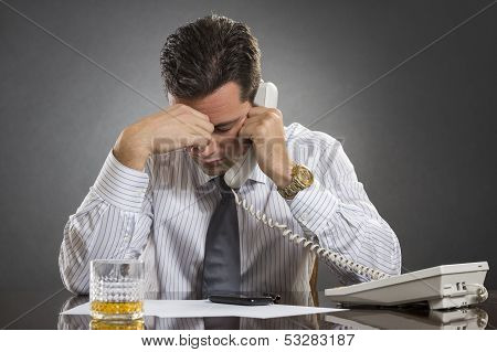 Stressed Businessman With Headache