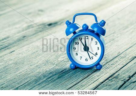 Vintage Wooden Background With Retro Alarm Clock