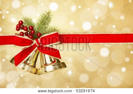 Jingle bells with red ribbon bow on festive background
