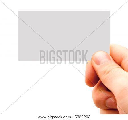 Mão segurando um cartão de visita