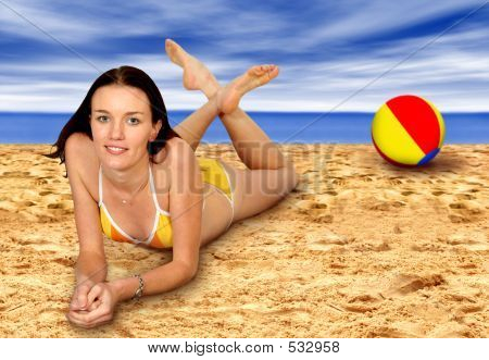 Ball And Girl At The Beach