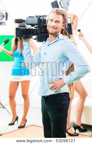 Camera man filming on set for video production an interview situation with actress or celebrity