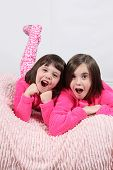 stock photo of little girls photo-models  - Adorable little girls posing for photos in PJ - JPG