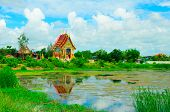 stock photo of northeast  - the temple and lagoon in northeast Thailand - JPG