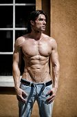 Muscular Young Bodybuilder Shirtless Outdoors