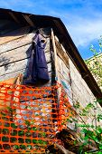 Vest Hanging On A Wooden Barn
