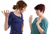 foto of annoyance  - woman not trusting her friend and isolated on a white background - JPG