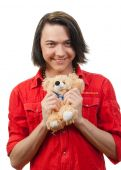 pic of gey  - Young guy with his loved from childhood toy  - JPG