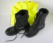 image of hse  - mid calf length black safety in front of folded high vis coat on white background - JPG