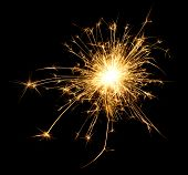 stock photo of backround  - A spark over black backround from a sparkler - JPG
