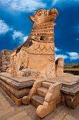 stock photo of chola  - Big statue of Nandi Bull in front of Hindu Gangaikonda Cholapuram Temple - JPG