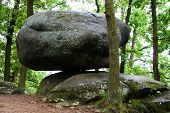 pic of shaky  - Large shaky stone in the forest in landscape of Czech Republic - JPG