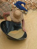 stock photo of gold panning  - Panning for gold in southern Borneo Indonesia - JPG